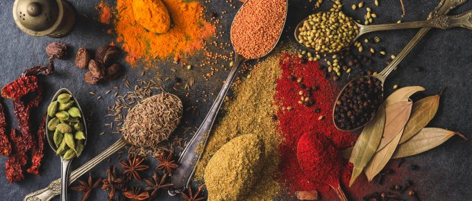 How does the freezer affect spices or herbs in dishes?